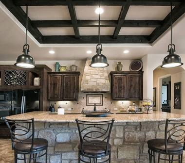 Kitchen with rock bar and dark cabinets